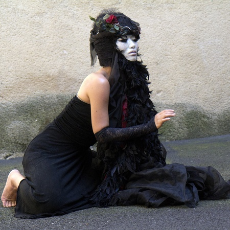 . AURILLAC, FRANCE- AUGUST 17: Barbara Murata dances as part of the Aurillac International Street Theater Festival,  show Doppelganger, on August 17, 2011 in Aurillac, France.