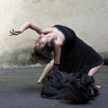 AURILLAC, FRANCE- AUGUST 17: Barbara Murata dances as part of the Aurillac International Street Theater Festival,  show Doppelganger, on August 17, 2011 in Aurillac, France.