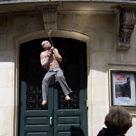 AURILLAC, FRANCE- AUGUST 18: An unidentified man plays in the street as part of the Aurillac International Street Theater Festival, cie