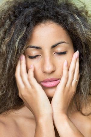 Close-up of a beautiful woman daydreaming photo