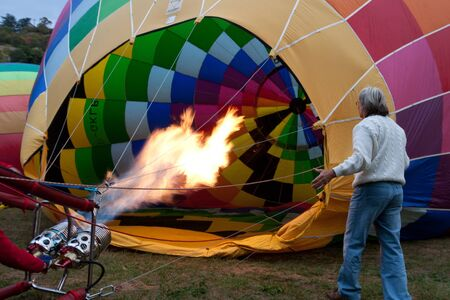 inflating: ROCAMADOUR, FRANCE- SEPTEMBER 24: Hot air balloon inflating at dawn for the 26�me Montgolfiades de Rocamadour, on September 24, 2011 in Rocamadour, France.  Editorial