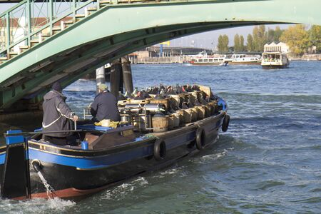 VENICE, ITALY,- NOVEMBER 23: A barge transporting large wine bottles on the Grand Canal , on November 23, 2011 in Venice, Italy.  Stock Photo - 11482013