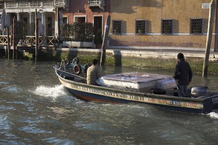 VENICE, ITALY,- NOVEMBER 25: Small barge transporting a bed  on the Grand Canal , on November 25, 2011 in Venice, Italy.  Stock Photo - 11482019