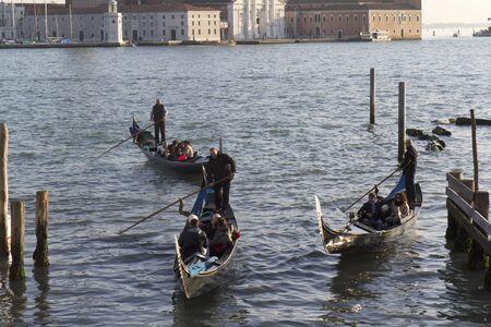 Venice, Italy - November 22, 2011:Three gondolas in the lagoon of Venice (Italy). Stock Photo - 11502017