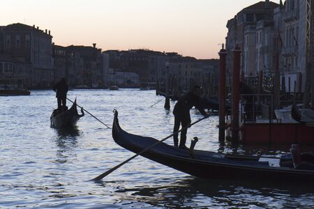 Venice, Italy - November 24, 2011:Two gondolas at the twilight near a jetty of the Grand Canal, in Venice (Italy). Stock Photo - 11502019