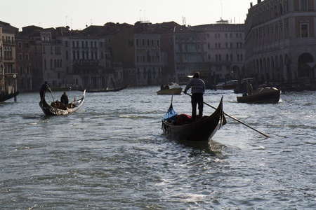 Venice, Italy - November 25, 2011: Two gondolas at the twilight in the middle of the Grand Canal,  in Venice (Italy).