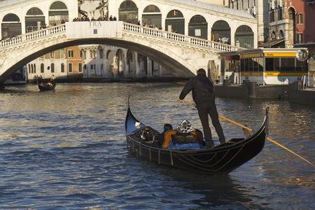 Venice, Italy - November 25, 2011:Gondolas near the Rialto bridge, in Venice (Italy). Stock Photo - 11502014