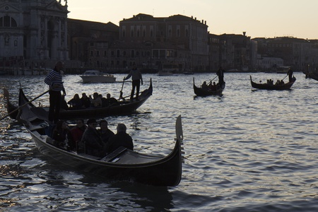 Venice, Italy - November 25, 2011: Four gondolas in Venice at the twilight. Stock Photo - 11502013