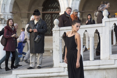VENICE, ITALY - NOVEMBER 26:  An unidentified female fashion model is posing during a public  photography session on the Riva Degli Schiavone , on November 26, 2011, in Venice, Italy.