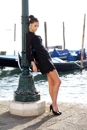 photography session: VENICE, ITALY - NOVEMBER 27: An unidentified female fashion model is posing during a public  photography session on the Riva Degli Schiavone near the lagoon , on November 27, 2011, in Venice, Italy.