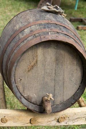 oak barrel: Closeup of a typical oak barrel with a tap. It is outdoors.
