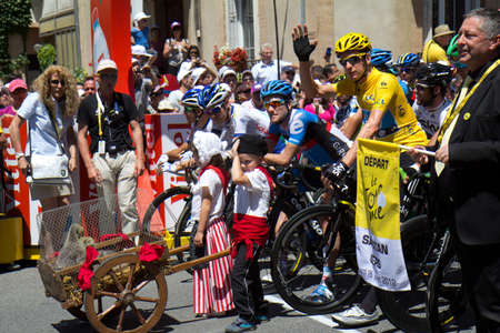 SAMATAN, FRANCE- JULY 16: Cyclists at the departure of the 15th stage of the Tour de France, from Samatan to Pau, on July 16, 2012 in Samatan, France.