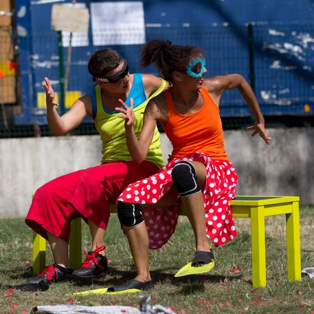AURILLAC, FRANCE - AUGUST 23 : Two dancers are moving on a bench as part of the Aurillac International Street Theater Festival,show by the Company Empreintes, on august 23, 2012, in Aurillac,France.  Editorial