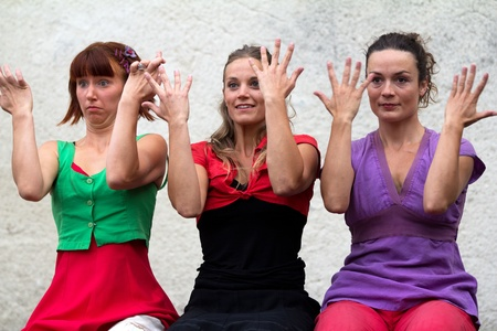 cantal: AURILLAC, FRANCE - AUGUST 24 : Three dancers playing with their hands as part of the Aurillac International Street Theater Festival, Company DAkipaya Danza , on august 24, 2012, in Aurillac,France.  Editorial