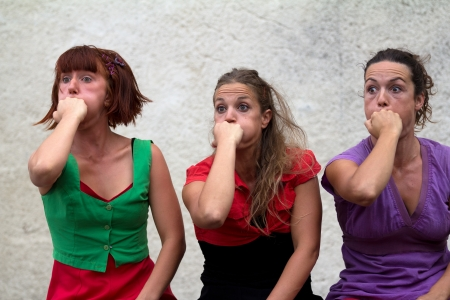 AURILLAC, FRANCE - AUGUST 24 : Funny faces of three women as part of the Aurillac International Street Theater Festival,show by the Company DAkipaya Danza , on august 24, 2012, in Aurillac,France.