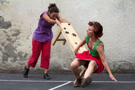 AURILLAC, FRANCE - AUGUST 24 : a dancer is knocking over a bench as part of the Aurillac International Street Theater Festival, Company D Stock Photo - 15054562