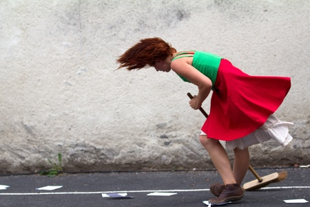 underskirt: AURILLAC, FRANCE - AUGUST 24 : dancer holding a broom as part of the Aurillac International Street Theater Festival,show by the Company DAkipaya Danza , on august 24, 2012, in Aurillac,France.