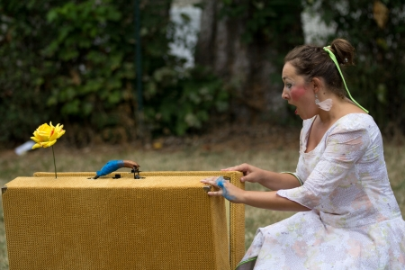 cantal: AURILLAC, FRANCE - AUGUST 23 : actress near an old suitcase as part of the Aurillac International Street Theater Festival,show Labeille bleue , on august 23, 2012, in Aurillac,France.  Editorial