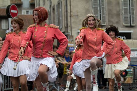 cantal: AURILLAC, FRANCE - AUGUST 24 : dress parade of mature majorettes as part of the Aurillac International Street Theater Festival, Company En Estafette , on august 24, 2012, in Aurillac,France.