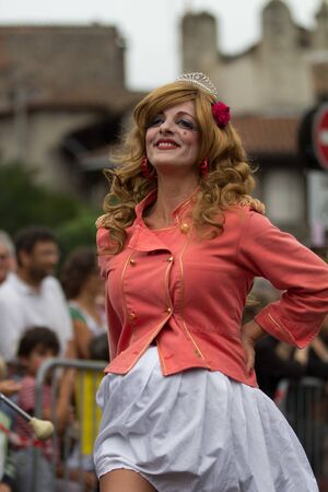cantal: AURILLAC, FRANCE - AUGUST 24 :  mature majorette as part of the Aurillac International Street Theater Festival, Company En Estafette , on august 24, 2012, in Aurillac,France.
