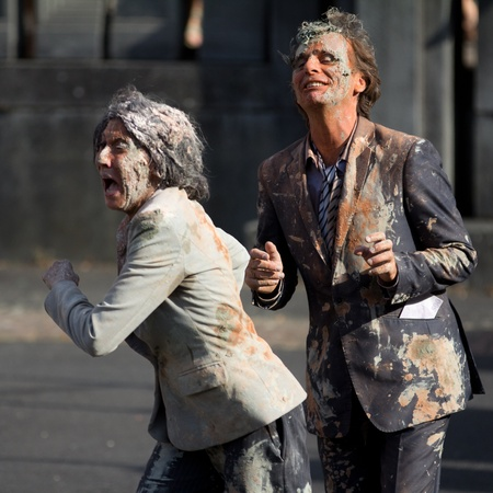 cantal: AURILLAC, FRANCE - AUGUST 22: very dirty and worrying actors in the street as part of the Aurillac International Street Theater Festival, Company n°8 ,on august 22, 2012, in Aurillac,France.