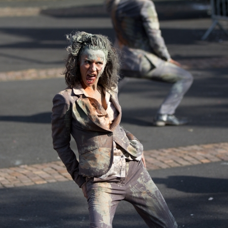 AURILLAC, FRANCE - AUGUST 22: a dirty and frightening woman in the street as part of the Aurillac International Street Theater Festival,show by the Company n°8 ,on august 22, 2012, in Aurillac,France.