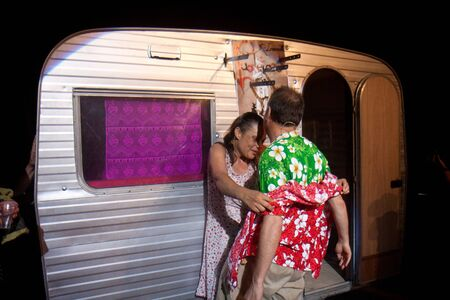 cantal: AURILLAC, FRANCE - AUGUST 22: Two actors play near a caravan as part of the Aurillac International Street Theater Festival,show by the Company Off ,on august 22, 2012, in Aurillac,France.