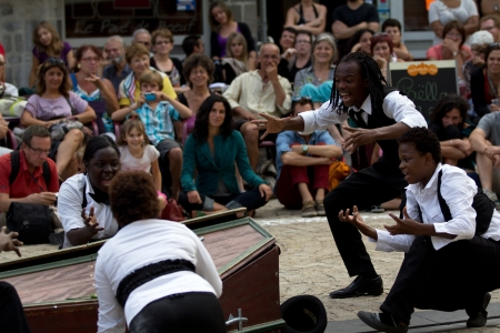 cantal: AURILLAC, FRANCE - AUGUST 24: incantations near a coffin, Aurillac International Street Theater Festival,  show by Brigade dintervention théâtrale Haïtienne, on august 24, 2012, in Aurillac,France.