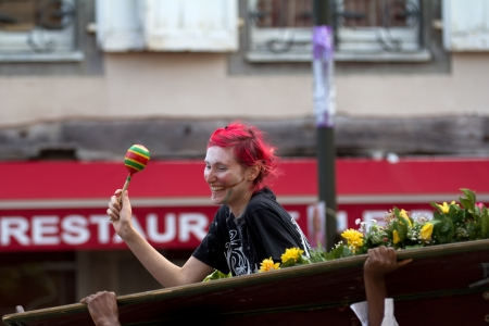 AURILLAC, FRANCE - AUGUST 24: woman laughing in a coffin,  Aurillac International Street Theater Festival,  show by Brigade d'intervention th��trale Ha�tienne, on august 24, 2012, in Aurillac,France. Stock Photo - 15102226