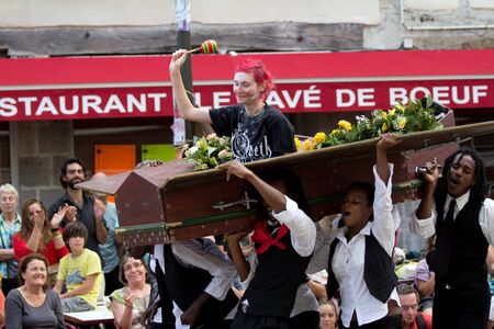 AURILLAC, FRANCE - AUGUST 24: spectator in a coffin as part of the Aurillac International Street Theater Festival,  Brigade d'intervention th��trale Ha�tienne, on august 24, 2012, in Aurillac,France. Stock Photo - 15102223