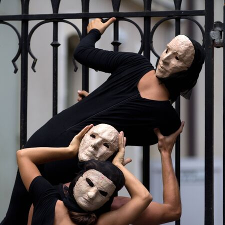 AURILLAC, FRANCE - AUGUST 23: enigmatic and worrying actors wearing a white mask, Aurillac International Street Theater Festival, show La diagonale du Fou, on august 23, 2012, in Aurillac,France. Stock Photo - 15103441
