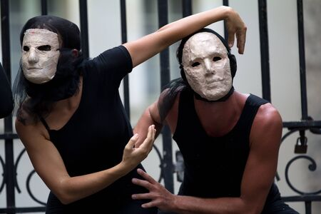diagonale: AURILLAC, FRANCE - AUGUST 23: mysterious actors wearing a white mask as part of the Aurillac International Street Theater Festival, show La diagonale du Fou, on august 23, 2012, in Aurillac,France. Editorial