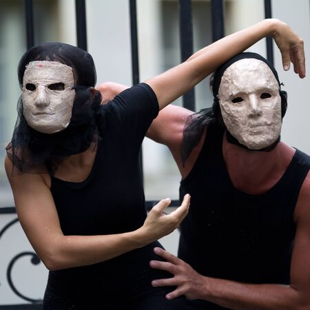 diagonale: AURILLAC, FRANCE - AUGUST 23: enigmatic actors wearing a white mask as part of the Aurillac International Street Theater Festival, show La diagonale du Fou, on august 23, 2012, in Aurillac,France.