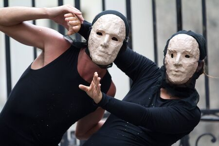 diagonale: AURILLAC, FRANCE - AUGUST 23: two actors wearing a white mask as part of the Aurillac International Street Theater Festival, show La diagonale du Fou, on august 23, 2012, in Aurillac,France. Editorial