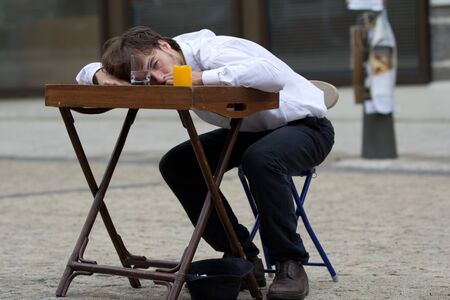 disheartened: AURILLAC, FRANCE - AUGUST 24: an actor is lying on a table as part of the Aurillac International Street Theater Festival, show by the Schizophr?s associ? on august 24, 2012, in Aurillac,France. Editorial