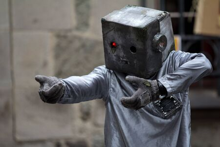 AURILLAC, FRANCE - AUGUST 24: an actor is playing as a nasty robot as part of the Aurillac International Street Theater Festival, show Robot Nozomi, on august 24, 2012, in Aurillac,France. Stock Photo - 15131880