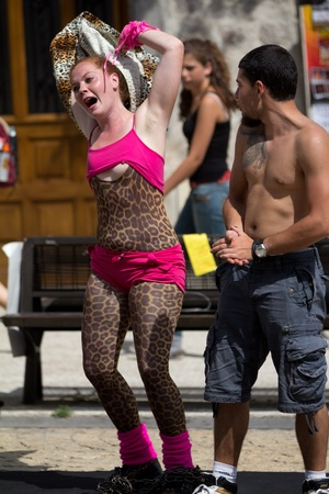 AURILLAC, FRANCE - AUGUST 23: An actress shows a breast in the street as part of the Aurillac International Street Theater Festival, show by Stacy Trong, on august 23, 2012, in Aurillac,France. Stock Photo - 15131891