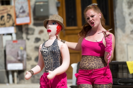 AURILLAC, FRANCE - AUGUST 23: A red-haired actress and her inflatable doll as part of the Aurillac International Street Theater Festival, show by Stacy Trong, on august 23, 2012, in Aurillac,France. Stock Photo - 15131890