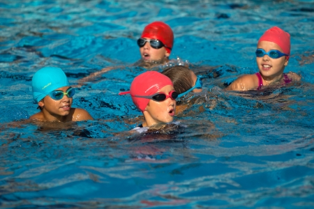 AUCH, FRANCE - SEPTEMBER 8: some unidentified young triathletes are waiting for the start,n the swimming pool, Auch Triathlon for children, on September 8, 2012 in Auch, France.
