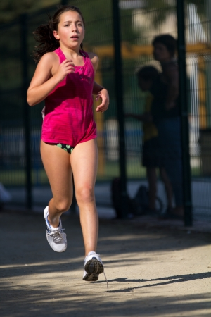 AUCH, FRANCE - SEPTEMBER 8: an unidentified young female runner, Auch Triathlon, on September 8, 2012 in Auch, France.