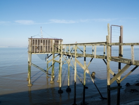 fishing cabin: Old fishing cabin and carrelet net, estuary of Gironde, Medoc, France  Stock Photo