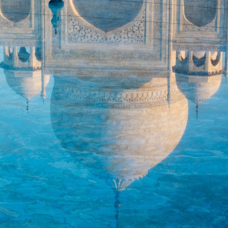 Reflection of the Taj Mahal dome in the water, Agra, India  photo