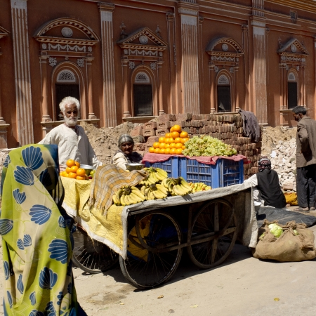 JAIPUR,  INDIA - MARCH 5: an elderly couple of vendors  is selling fruits in a street of the city, on March 5, 2013, Jaipur, India.