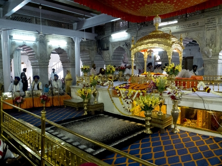 gurudwara: NEW DELHI,  INDIA - MARCH 14:  Interior of the Sikh temple of Old Delhi, named Gurudwara Sish Ganj Sahib, on March 14, 2013, New Delhi, India. It is one of the nine historical gurdwaras in Delhi.