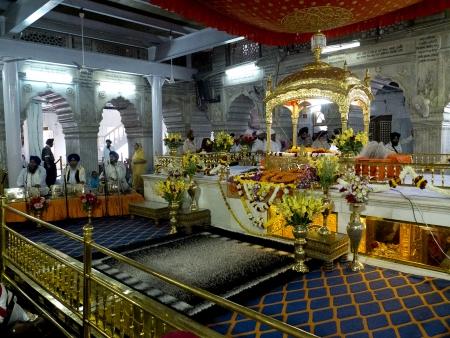 gurudwara: NEW DELHI,  INDIA - MARCH 14:  Interior of the Sikh temple of Old Delhi, named Gurudwara Sish Ganj Sahib, on March 14, 2013, New Delhi, India. It is one of the nine historical gurdwaras in Delhi.