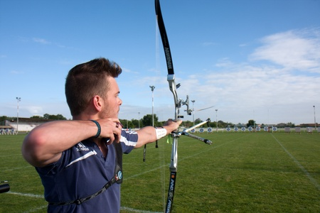 AUCH, FRANCE - MAY 11:  an unidentified competitor is shooting with a bow and an arrow, at the National tournament for young archers, on May 11, 2013, in Auch, France.