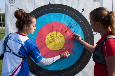 AUCH, FRANCE - MAY 11:  two people are checking their archery accuracy, at the National competition for young archers, on May 11, 2013, in Auch, France.  Editorial