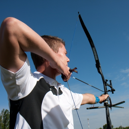 AUCH, FRANCE - MAY 11:  an unidentified male competitor is ready to shoot with a bow and an arrow, at the National tournament for young archers, on May 11, 2013, in Auch, France.  Editorial