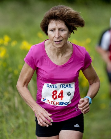 PAVIE, FRANCE - JUNE 23:Portrait of an elderly runner at the Trail of Pavie, on June 23, 2013, in Pavie, France.
