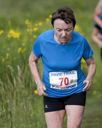 PAVIE, FRANCE - JUNE 23: Elderly female runner at the Trail of Pavie, on June 23, 2013, in Pavie, France.